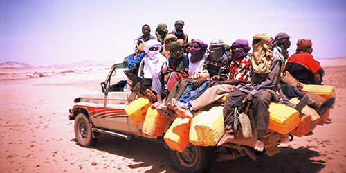 Up to 32 passengers find place on a so called Toyota Station, a pick-up 4-wheel-drive undertaking the three days journey from Arlit in Niger to Djanet in Algeria (Photo: Akidima Effad 2007)