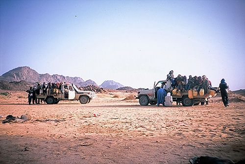 "Typical ishumar-travelling (called afrod) between Niger and Algeria. 20 to 30 passengers climb one Toyota and cross together with several cars the borders. The transit routes across the Sahara represents a rite of passage which must be ""experienced"" by all ishumar at least once in their lives. (Photos: Akidima Effad, August 2007)"